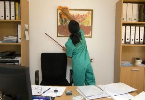 facility management cleaning person cleaning office